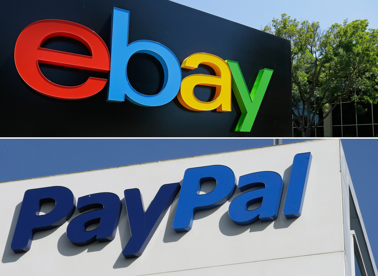 This combo made from file photos shows the eBay, top, and PayPal logos at their headquarters buildings in San Jose, Calif. The mobile payment service PayPal is splitting from eBay and will become a separate and publicly traded company in 2015, eBay announced Tuesday, Sept. 30, 2014. (AP Photo)
